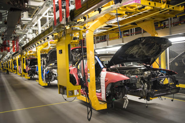 Cars on an assembly line at a Jaguar Land Rover plant in Birmingham. Photo: PA