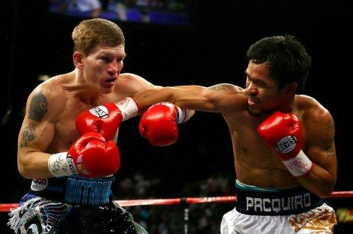 Manny Pacquiao of the Philippines (right) throws a right to the face of England's Ricky Hatton in the first round of their junior welterweight title fight on May 2, 2009 in Las Vegas. Hatton says he has put his drugs, drink and depression nightmare behind him as he relishes his new life outside the ring as a promoter