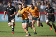 Australia's Noah Lolesio makes a run during the Rugby Championship game between the All Blacks and the Wallabies in Perth, Australia, Sunday, Sept. 5, 2021. (AP Photo/Gary Day)