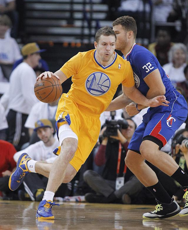 Golden State Warriors forward David Lee (10) drives to the basket against Los Angeles Clippers forward Blake Griffin (32) during the first half of an NBA basketball game, Wednesday, Dec. 25, 2013, in Oakland, Calif. (AP Photo/Tony Avelar)