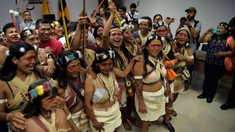 Waorani indigenous people celebrate after a court ruled in their favour on the tribe`s legal challenge to the government`s land selloff, at the end of the protection action hearing in Puyo, Ecuador, on April 26, 2019.