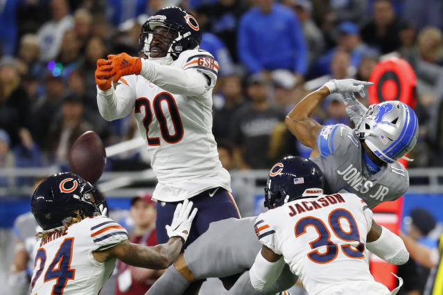 Chicago Bears cornerback Prince Amukamara (20), free safety Eddie Jackson (39), and cornerback Buster Skrine (24) help break up the pass intended for Detroit Lions wide receiver Marvin Jones (11) during the second half of an NFL football game, Thursday, Nov. 28, 2019, in Detroit. (AP Photo/Paul Sancya)