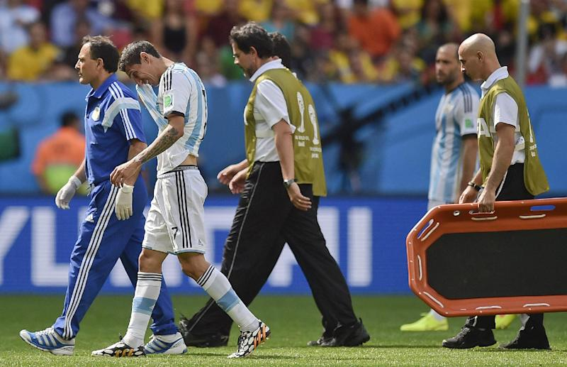 Argentina's Angel di Maria, second left, leaves the field with an injury during the World Cup quarterfinal soccer match between Argentina and Belgium at the Estadio Nacional in Brasilia, Brazil, Saturday, July 5, 2014