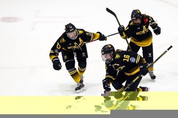 Lexie Laing (16) of the Boston Pride celebrates a goal against the Minnesota Whitecaps with teammates Kaleigh Fratkin (13) and Jillian Dempsey (14) in the Isobel Cup Championship game on Saturday.  (Maddie Meyer/Getty Images - image credit)