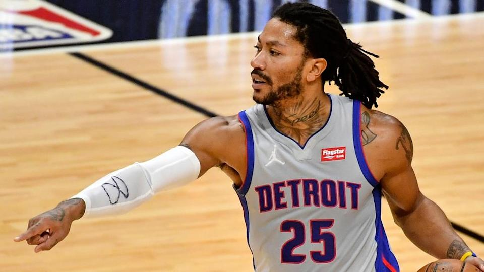 Derrick Rose points for a screen in Pistons uniform
