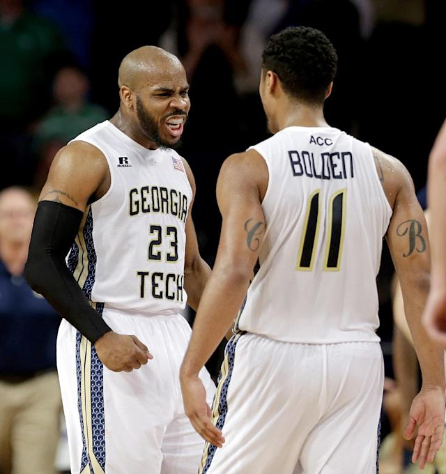 Georgia Tech's Trae Golden, left, celebrates with teammate Chris Bolden after Tech defeated Notre Dame 74-69 in an NCAA college basketball game, Saturday, Jan. 11, 2014, in Atlanta. (AP Photo/David Goldman)