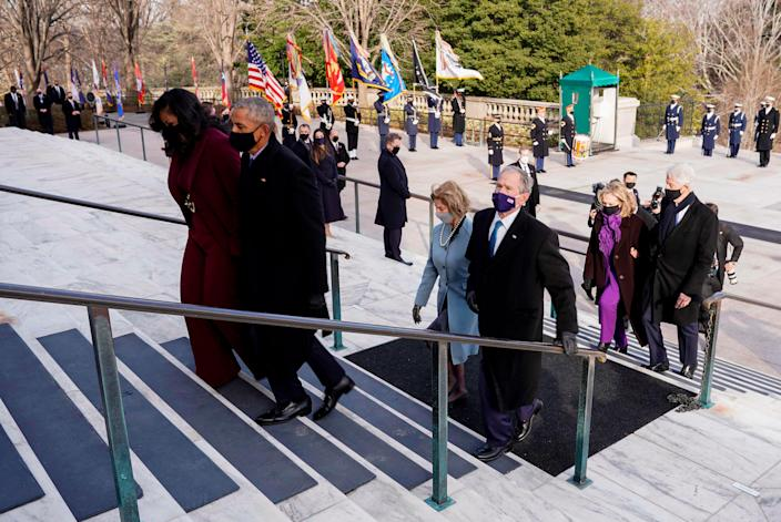 (From R) US former President Bill Clinton with wife former US First Lady and Secretary of State Hillary Clinton, former US President George W. Bush with his wife former US First Lady Laura Busha, former US President Barack Obama and his wife former US First Lady Michelle Obama attend a wreath laying ceremony at the Tomb of the Unknown Soldier in Arlington Cemetery in Arlington, Virginia, after being sworn in, on January 20, 2021. (Photo by JOSHUA ROBERTS / POOL / AFP) (Photo by JOSHUA ROBERTS/POOL/AFP via Getty Images) ORG XMIT: 0 ORIG FILE ID: AFP_8Z87TV.jpg