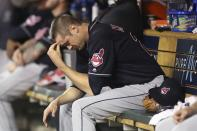 Cleveland Indians relief pitcher Andrew Miller sits in the dugout after being removed, having given up a bases-loaded walk during the seventh inning of a baseball game against the Detroit Tigers, Tuesday, May 15, 2018, in Detroit. (AP Photo/Carlos Osorio)
