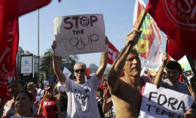 People opposed to the impeachment of Brazil's former President Dilma Rousseff attend a demonstration against interim President Michel Temer on Copacabana before the opening ceremony of the Rio 2016 Olympic Games in Rio de Janeiro, August 5, 2016. REUTERS/Carlos Barria