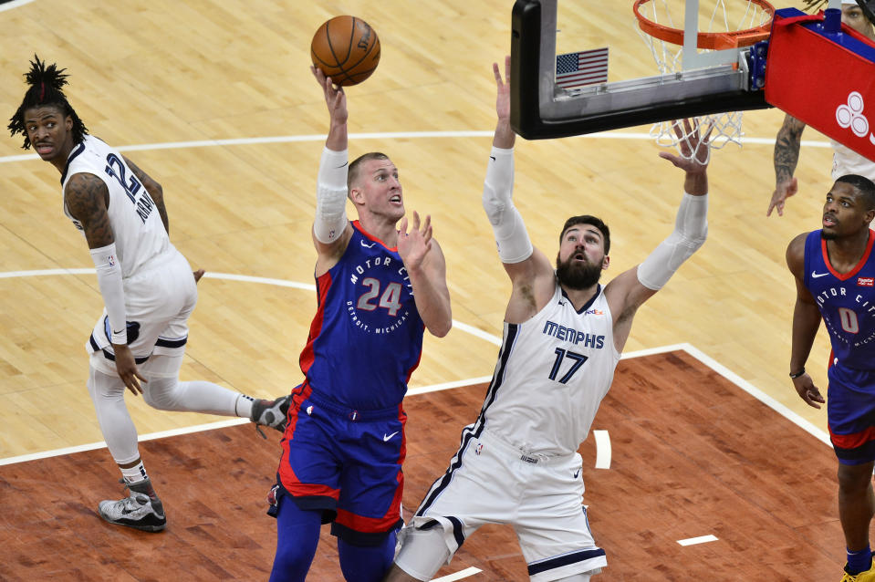 Detroit Pistons center Mason Plumlee (24) shoots against Memphis Grizzlies center Jonas Valanciunas (17) during the second half of an NBA basketball game Friday, Feb. 19, 2021, in Memphis, Tenn. (AP Photo/Brandon Dill)
