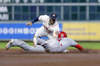Houston Astros second baseman Jose Altuve, left, makes the tag for the out on Los Angeles Angels third baseman Taylor Ward, right, on his attempted steal during the third inning of a baseball game Tuesday, May 11, 2021, in Houston. (AP Photo/Michael Wyke)