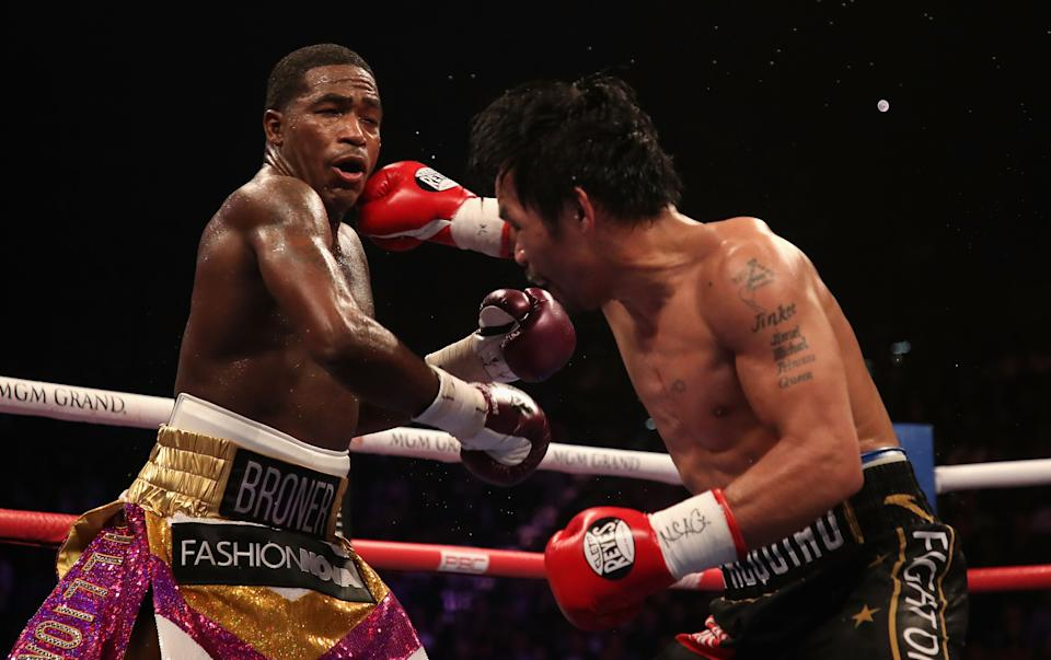 Manny Pacquiao (pictured right) throws a right on Adrien Broner (pictured left) during the WBA welterweight championship at MGM Grand Garden Arena on January 19, 2019 in Las Vegas, Nevada.
