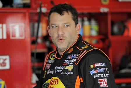 NASCAR Sprint Cup Series driver Tony Stewart speaks with crew members during practice for the Daytona 500 qualifying at Daytona International Speedway in Daytona Beach, Florida, in this file photo taken February 16, 2013. REUTERS/Brian Blanco