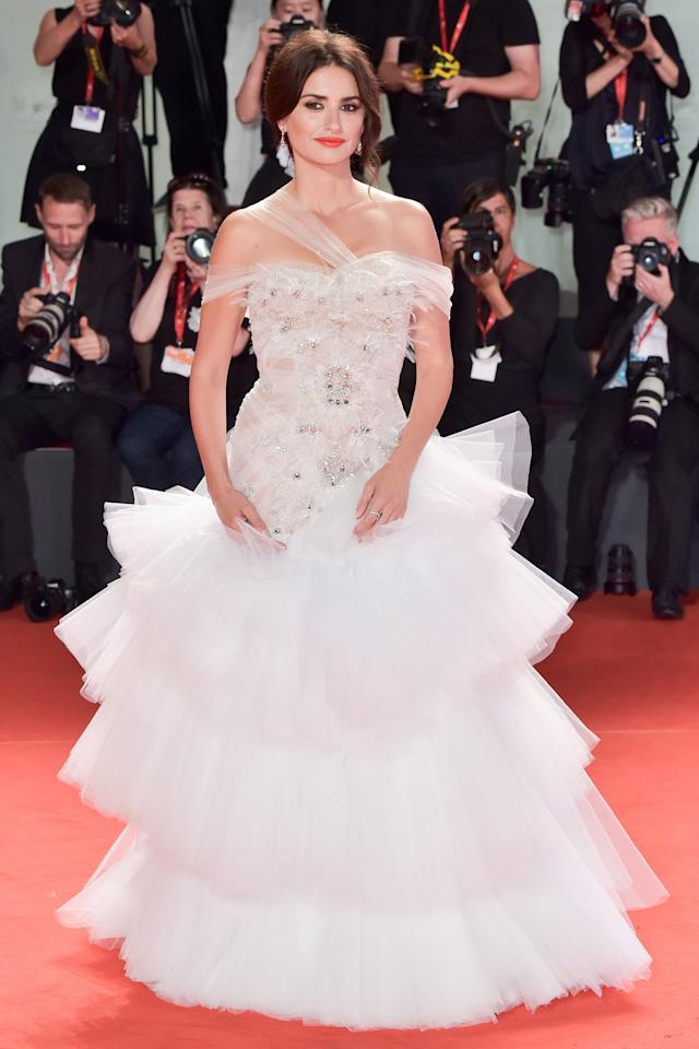 in a multi-layered Ralph & Russo Couture tulle ballgown with a tiered frill skirt and embellished bodice and Atelier Swarovski drop earrings to the premiere of <em>Wasp Network</em>.
