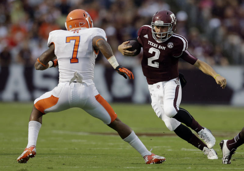 Texas A&M quarterback Johnny Manziel (2) rushes for a gain as Sam Houston State safety Johntel Franklin (7) defends during the first quarter of an NCAA college football game Saturday, Sept. 7, 2013, in College Station, Texas. (AP Photo/David J. Phillip)