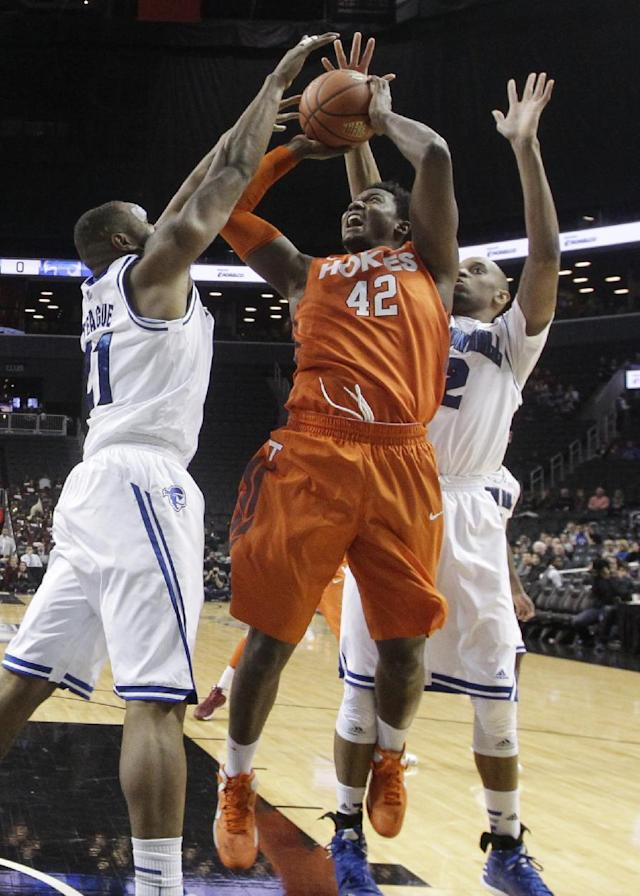 Virginia Tech's C.J. Barksdale (42) is defended by Seton Hall's Gene Teague (21) and Brandon Mobley (2) during the first half of a consolation game in the Coaches vs. Cancer NCAA college basketball game on Saturday, Nov. 23, 2013, in New York. (AP Photo/Frank Franklin II)