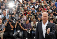 """Cast member Bruce Willis poses during a photocall for the film """"Moonrise Kingdom"""", by director Wes Anderson, in competition at the 65th Cannes Film Festival, May 16, 2012. REUTERS/Eric Gaillard (FRANCE - Tags: ENTERTAINMENT)"""