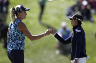 Lexi Thompson, left, knuckles Yuka Saso, of the Philippines, on the 18th green during the final round of the U.S. Women's Open golf tournament at The Olympic Club, Sunday, June 6, 2021, in San Francisco. (AP Photo/Jed Jacobsohn)