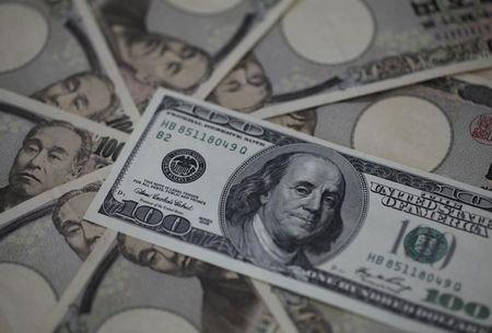 A U.S. one-hundred dollar bill and Japanese 10,000 yen notes are spread in Tokyo