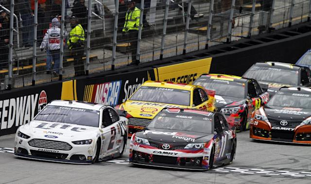 Driver Denny Hamlin (11) and Brad Keselowski (2) lead the field to start the NASCAR Sprint Cup series auto race at Bristol Motor Speedway on Sunday, March 16, 2014, in Bristol, Tenn. (AP Photo/Wade Payne)