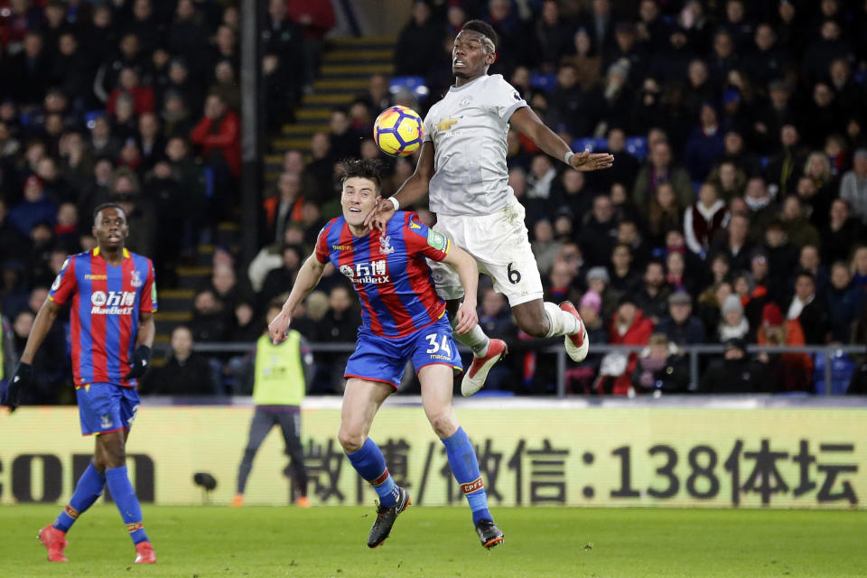 Manchester United's Paul Pogba, right, competes for the ball with Crystal Palace's Martin Kelly during the English Premier League soccer match between Crystal Palace and Manchester United at Selhurst Park in London, Monday, March 5, 2018. (AP Photo/Tim Ireland)