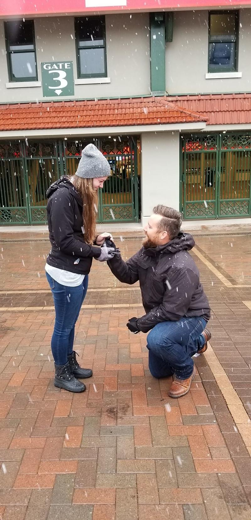 A photo of Clinton Parkinson down on one knee in front of his Chicago-native girlfriend Clohe Ludwig. (Credit: Clinton Parkinson)