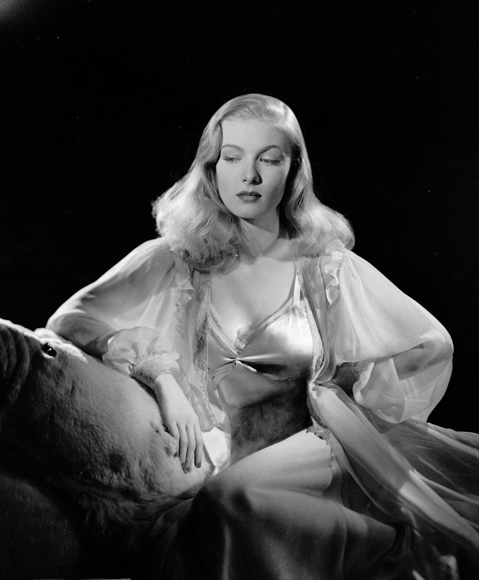 Lake wears a negligee and dressing gown, circa 1942.