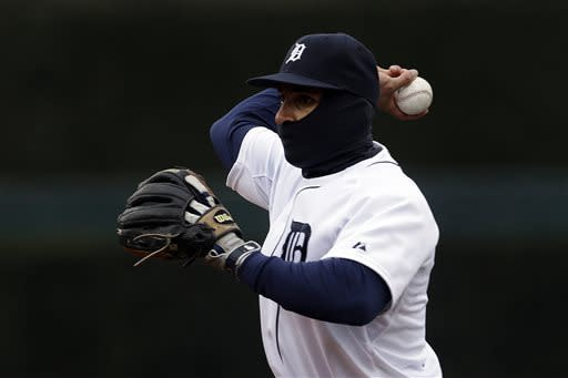 Detroit Tigers second baseman Omar Infante throws out Toronto Blue Jays' Colby Rasmus in the fourth inning of a baseball game in Detroit, Thursday April 11, 2013. Temperatures were in the 30's. (AP Photo/Paul Sancya)