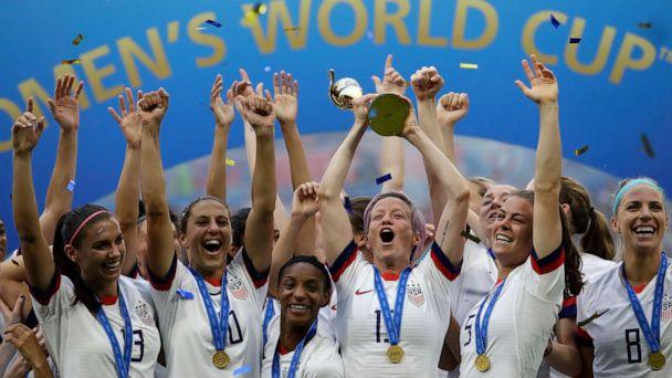 PHOTO: In this July 7, 2019, file photo, United States' Megan Rapinoe lifts up a trophy after winning the Women's World Cup final soccer match between US and The Netherlands at the Stade de Lyon in Decines, outside Lyon, France. (Alessandra Tarantino/AP, File)