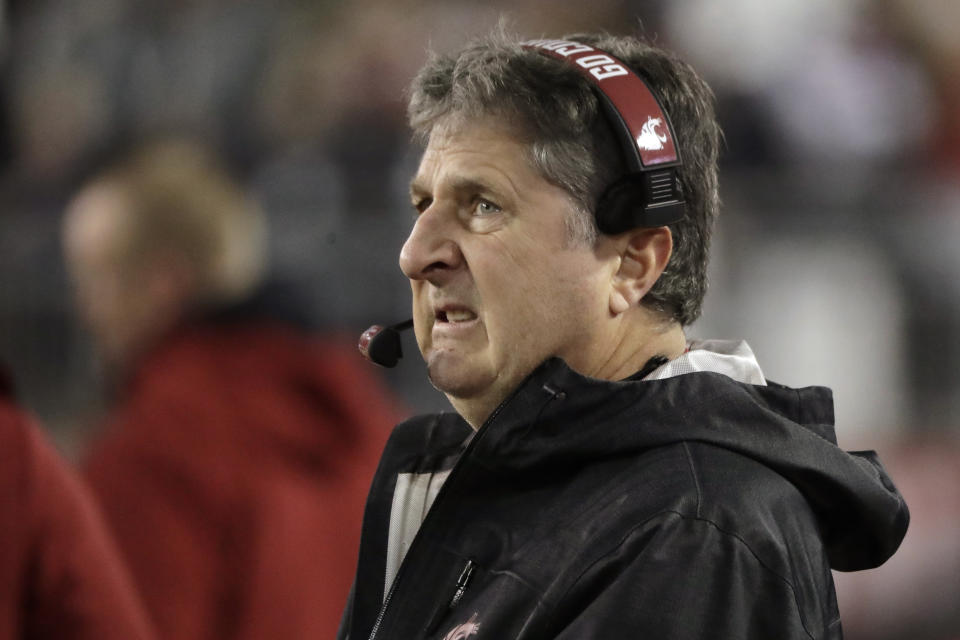 Mike Leach was not in a chipper mood after losing the Apple Cup for the seventh year in a row. (AP Photo/Ted S. Warren)