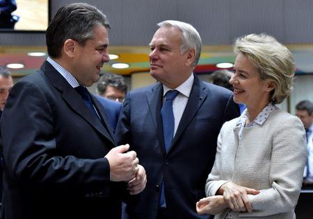 German Defence Minister von der Leyen and French Foreign Minister Ayrault listen to German Foreign Minister Gabriel during a joint meeting of European Union foreign and interior ministers at the EU Council in Brussels