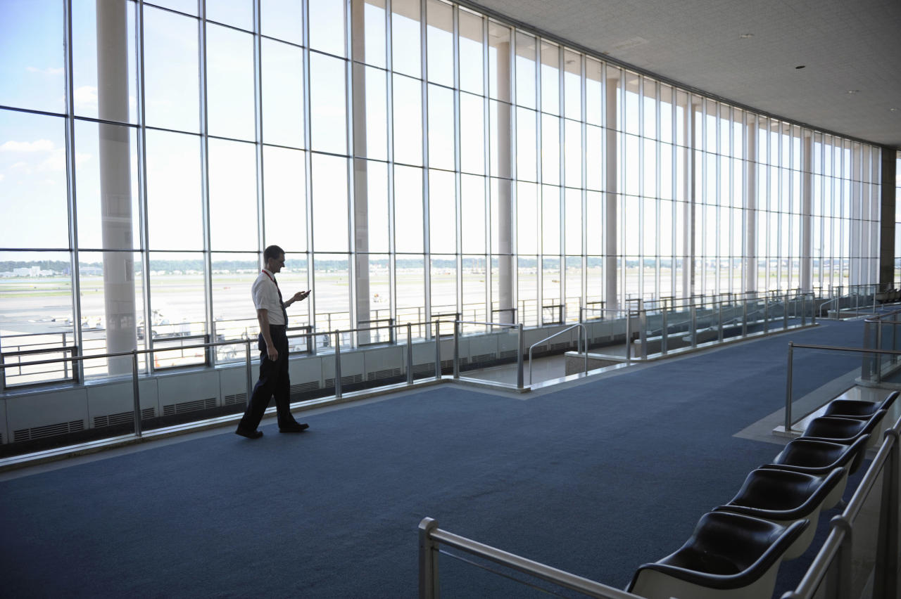 An employee of Washington's Ronald Reagan National Airport stands in an empty Terminal A, Tuesday, Aug. 23, 2011, after an earthquake in the Washington area. A 5.9 magnitude earthquake centered in Virginia forced evacuations of all the monuments on the National Mall in Washington and rattled nerves from Georgia to Martha's Vineyard, the Massachusetts island where President Barack Obama is vacationing. No injuries were immediately reported. (AP Photo/Cliff Owen)