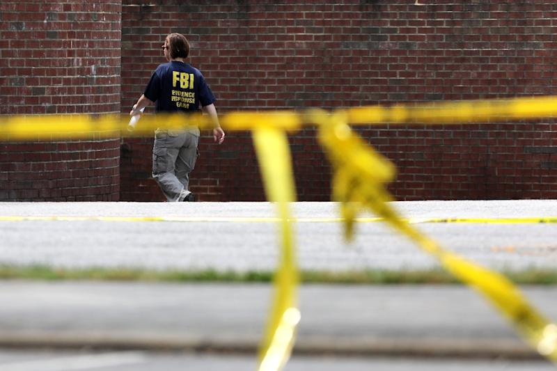 A FBI agent at the scene of a mass shooting that killed 12 people in Virginia Beach, Virginia on May 31, 2019 (AFP Photo/CHIP SOMODEVILLA)