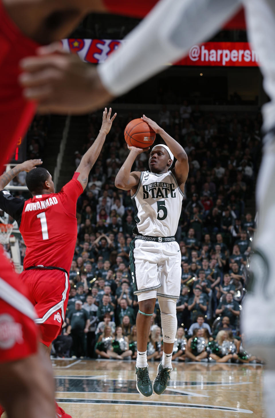 Michigan State's Cassius Winston (5) shoots against Ohio State's Luther Muhammad (1) during the second half of an NCAA college basketball game, Sunday, March 8, 2020, in East Lansing, Mich. (AP Photo/Al Goldis)