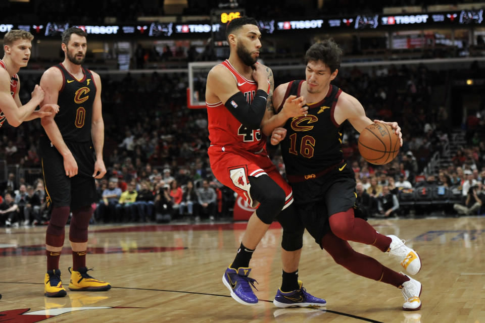 Cleveland Cavaliers' Cedi Osman (16) drives against Chicago Bulls' Denzel Valentine (45) during the first half of an NBA basketball game Tuesday, March 10, 2020, in Chicago. (AP Photo/Paul Beaty)