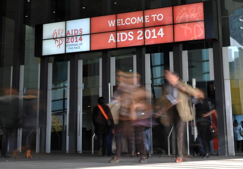 People attend the AIDS Conference 2014 at the Melbourne Convention and Exhibition Centre (MCEC) in Melbourne on July 22, 2014 (AFP Photo/Esther Lim)