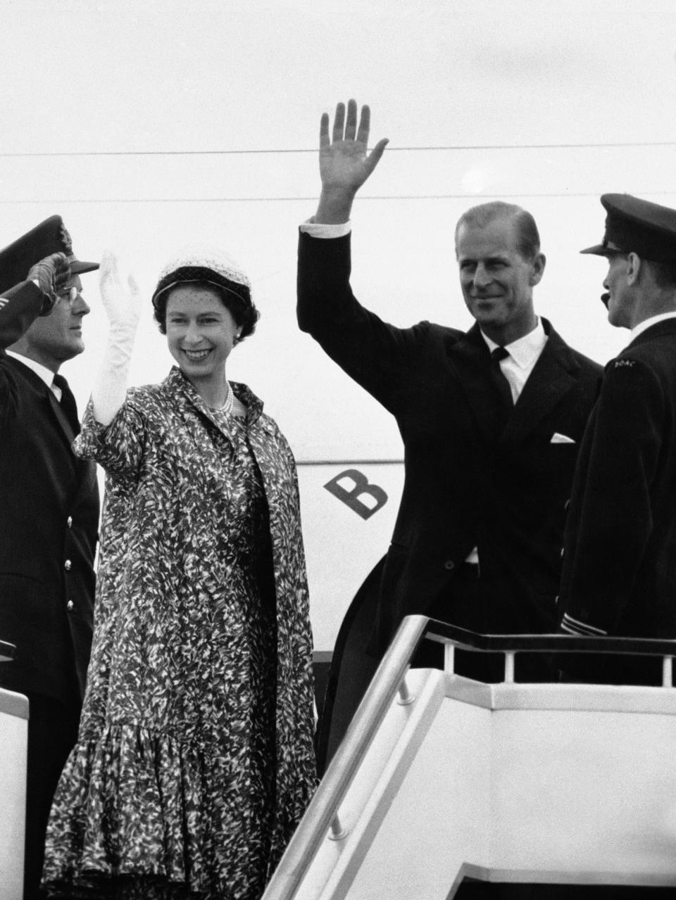 FILE - In this file photo dated June 18, 1959, Prince Philip waves as he and Queen Elizabeth II stand at top of plane ramp at London Airport, prior to their departure by jet airliner for 45-day tour of Canada. Prince Philip who died Friday April 9, 2021, aged 99, lived through a tumultuous century of war and upheavals, but he helped forge a period of stability for the British monarchy under his wife, Queen Elizabeth II. Philip helped create the Commonwealth of nations, with the queen at its head, in an attempt to bind Britain and its former colonies together on a more equal footing. (AP Photo, FILE)