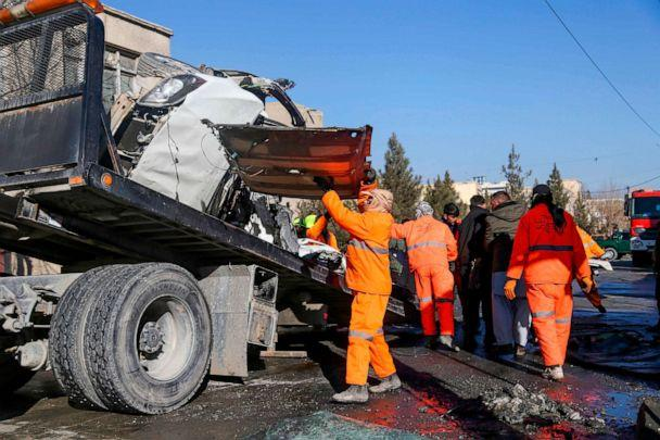 PHOTO: Municipal workers clean up debris at the site of a bomb attack in Kabul, Afghanistan, Dec. 22, 2020. (Zakeria Hashimi/AFP via Getty Images)