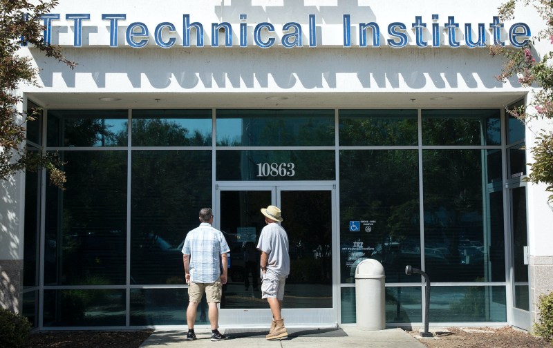 Harold Poling, left, and Ted Weisenberger check the doors to the ITT Technical Institute after ITT Educational Services announced that the school had ceased operating in Rancho Cordova, Calif. on Sept. 6, 2016. (AP: Rich Pedroncelli)