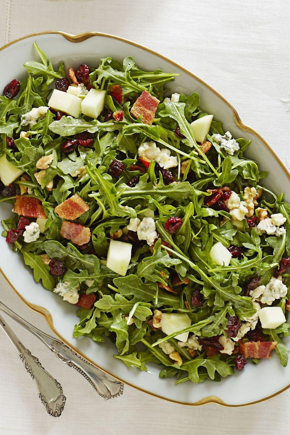 "<p>Bacon and blue cheese give this salad an exciting twist, while the orange dressing, arugula, and apples keep it lively and fresh.</p><p><em><a href=""https://www.goodhousekeeping.com/food-recipes/a11597/cape-cod-chopped-salad-recipe-ghk1113/"" rel=""nofollow noopener"" target=""_blank"" data-ylk=""slk:Get the recipe for Cape Cod Chopped Salad »"" class=""link rapid-noclick-resp"">Get the recipe for Cape Cod Chopped Salad »</a></em></p><p><strong>RELATED: </strong><a href=""https://www.goodhousekeeping.com/holidays/thanksgiving-ideas/g1918/thanksgiving-dinner-recipes/"" rel=""nofollow noopener"" target=""_blank"" data-ylk=""slk:76 Best Thanksgiving Dinner Ideas of All Time"" class=""link rapid-noclick-resp"">76 Best Thanksgiving Dinner Ideas of All Time</a></p>"
