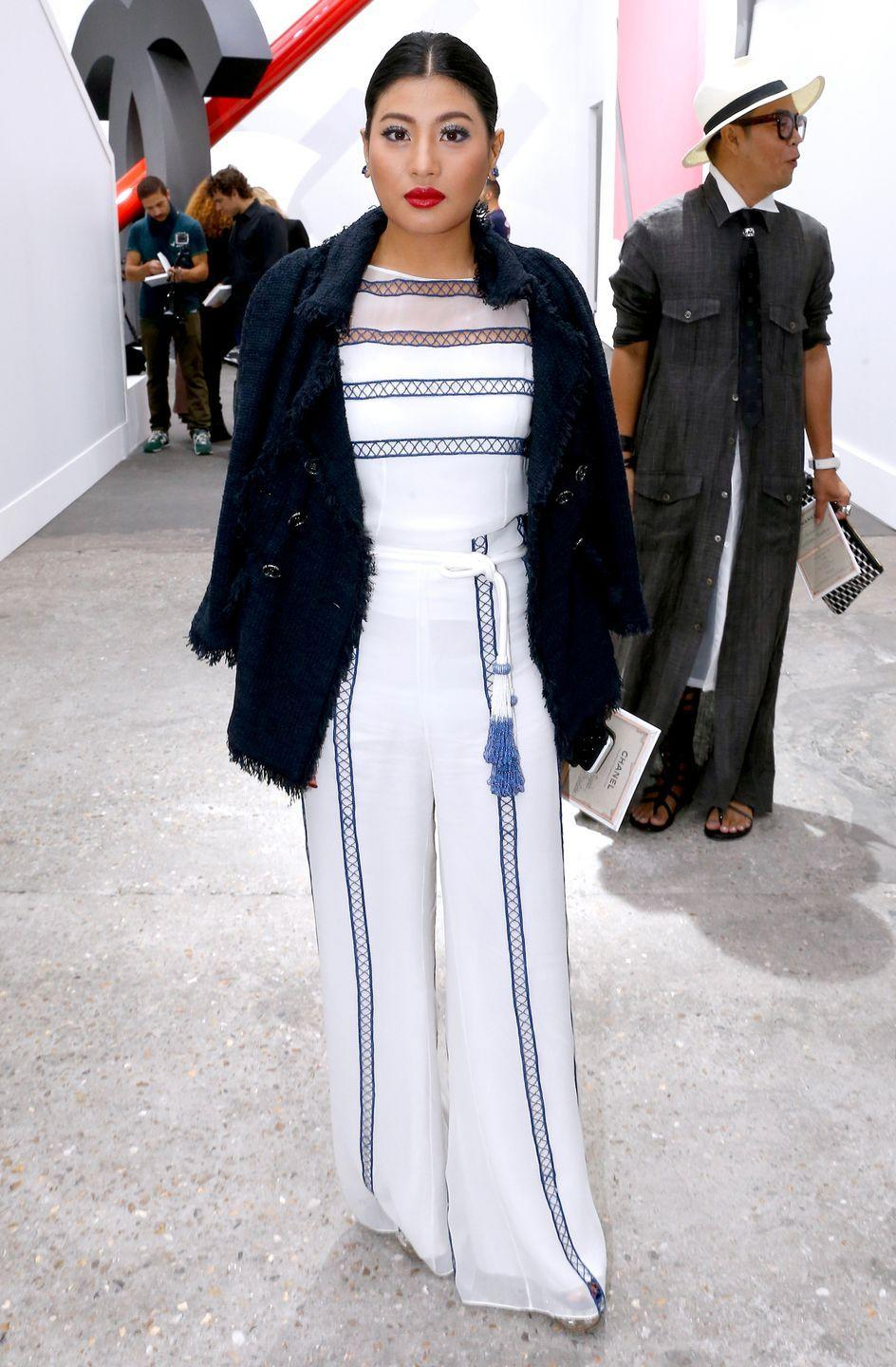 <p>She's been spotted front row at couture shows, such as Chanel (pictured here) and Christian Dior, and is a devotee and supporter of Balmain.</p>