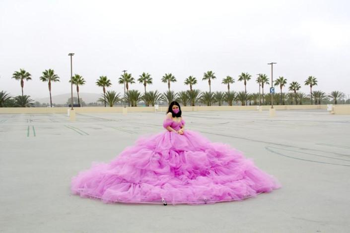 Shay Rose in her 12ft social distancing dress, during a photoshoot at an empty parking lot at the Irvine Spectrum - the only location she could think of that could fit the dress.