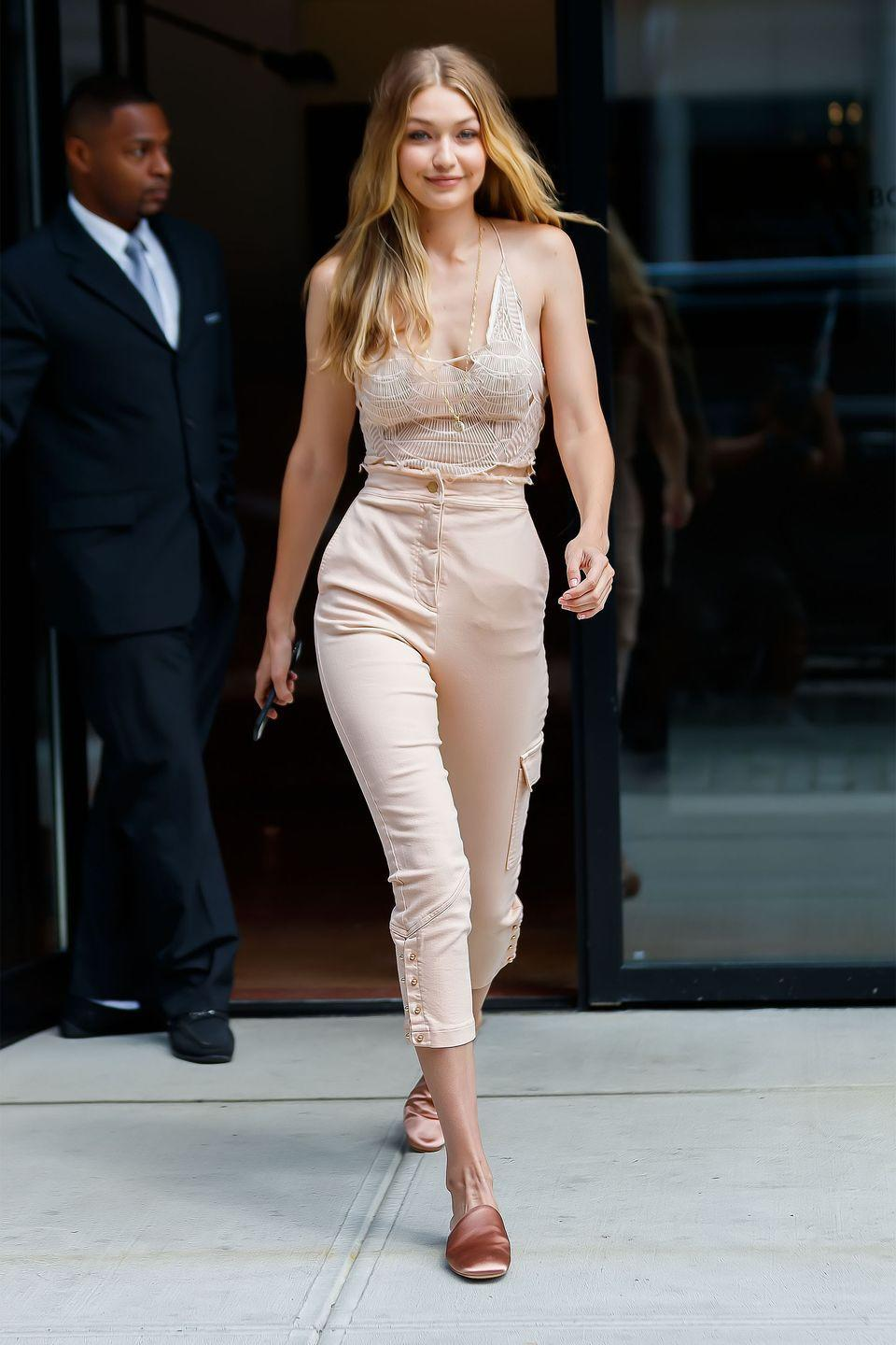 <p>In a crocheted halter top with cropped Manning Cartell pants and pink satin slides while out in New York City for the Victoria's Secret Fashion Show fittings</p>