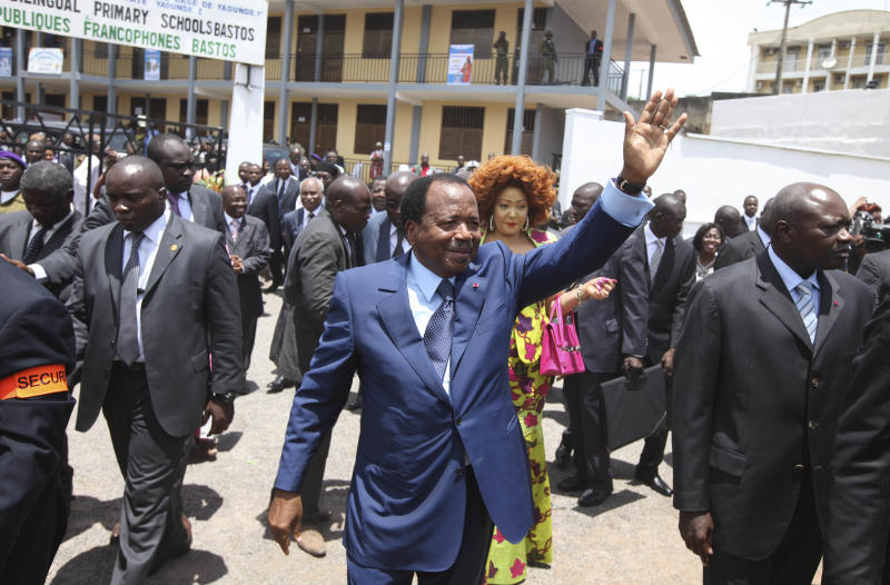 Cameroon Incumbent President, Paul Biya ,wave to the crown after casting his vote during the Presidential election  in Yaounde, Cameroon, Sunday, Oct. 9. 2011. Cameroonian  go to the polls Sunday to elect a new President (AP Photo/Sunday Alamba)