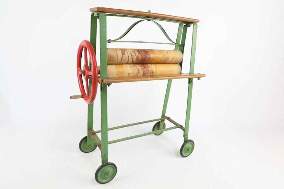 <p>Dating back to the 1930s, this clothes mangle was used by children to teach them how to do the washing. </p>