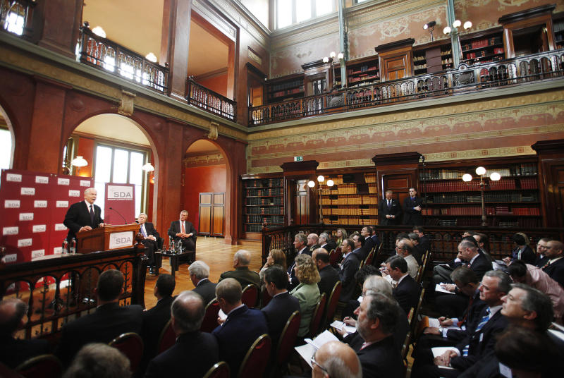 FILE - In this June 10, 2011, file photo then U.S. Defense Secretary Robert Gates gives his final policy speech as Pentagon Chief during a Security and Defense Agenda meeting at the Biblioteque Solvay in Brussels. Gates questioned the viability of NATO, saying its members' penny-pinching and lack of political will could hasten the end of U.S. support. (AP Photo/Jason Reed, Pool)