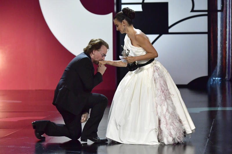 Singer Bono, left, kisses the hand of actress Penelope Cruz after she received the Donostia Award during an award ceremony at the 67th San Sebastian Film Festival, in San Sebastian, northern Spain Friday, Sept. 27, 2019. (AP Photo/Alvaro Barrientos)