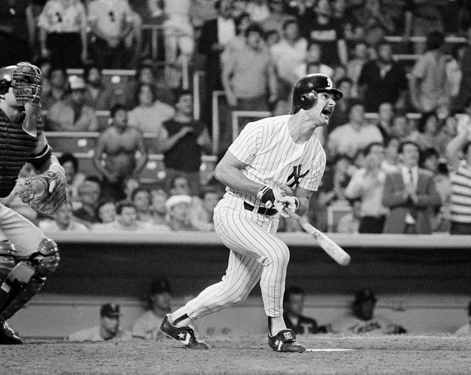 FILE - New York Yankees' Don Mattingly opens his mouth and watches his three run home run against the Minnesota Twins with two out in the bottom of the ninth leave Yankee Stadium in New York, in this May 13, 1985, file photo. The homer enabled the Yankees to win 9-8 over the Twins. The former New York Yankees' American League batting champion knows his place now is in the dugout. As manager of the Miami Marlins, Don Mattingly finds it easy to resist any temptation to step to the plate and show his pitchers who he is — or was.(AP Photo/Ray Stubblebine, File)