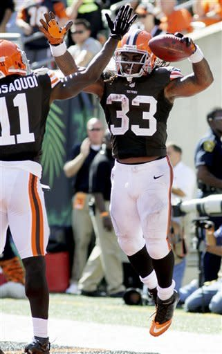 Cleveland Browns running back Trent Richardson (33) celebrates with Mohamed Massaquoi (11) after scoring on a pass reception in the second half of an NFL football game against the Cincinnati Bengals, Sunday, Sept. 16, 2012, in Cincinnati. (AP Photo/Tom Uhlman)