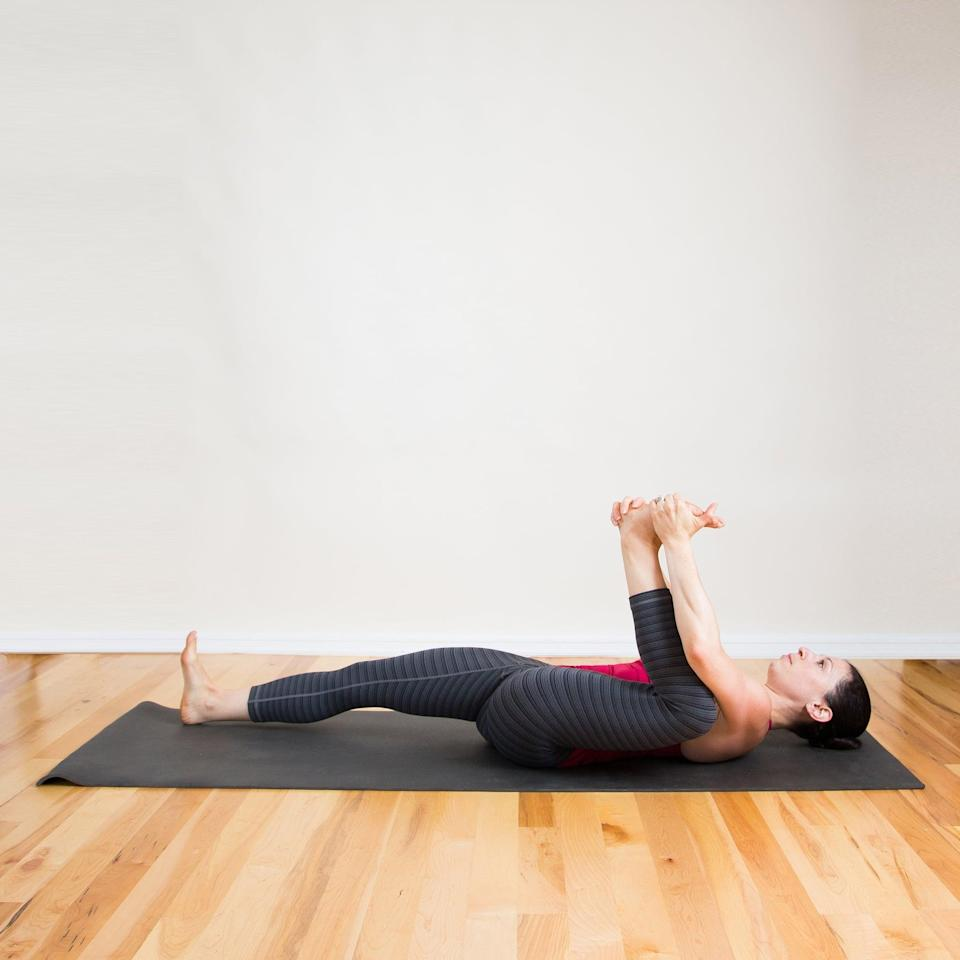 <ul> <li>Lying on your back, bend the left knee and hold the left foot with both hands.</li> <li>Relax the torso and gently pull your knee toward the bed, keeping the shoulders and head relaxed.</li> <li>Hold this pose for 30 seconds. Repeat on the other side.</li> </ul>